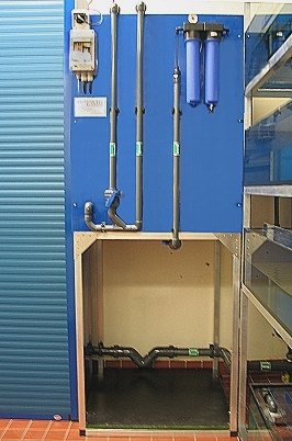 Water treatment facility with reverse osmosis system / left side: PP-Module with roller blind / right side: Xenopus racks